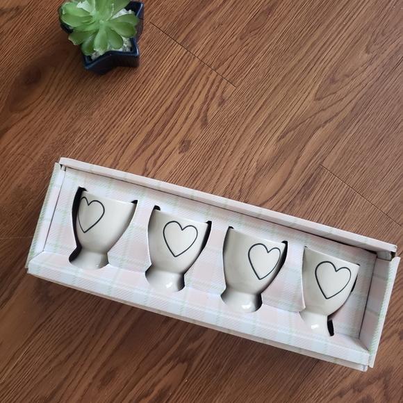 Rae Dunn white heart egg cups.